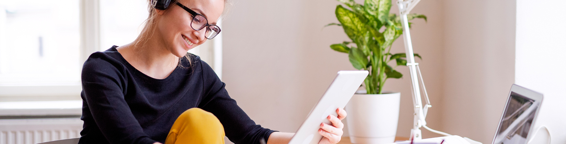 Image of a woman looking at tablet device